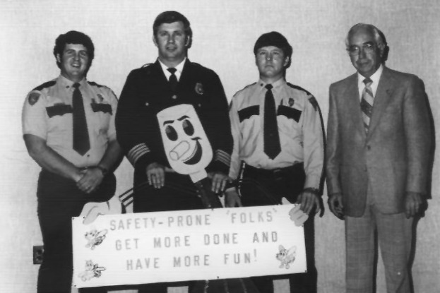 Group with sign with John Hill