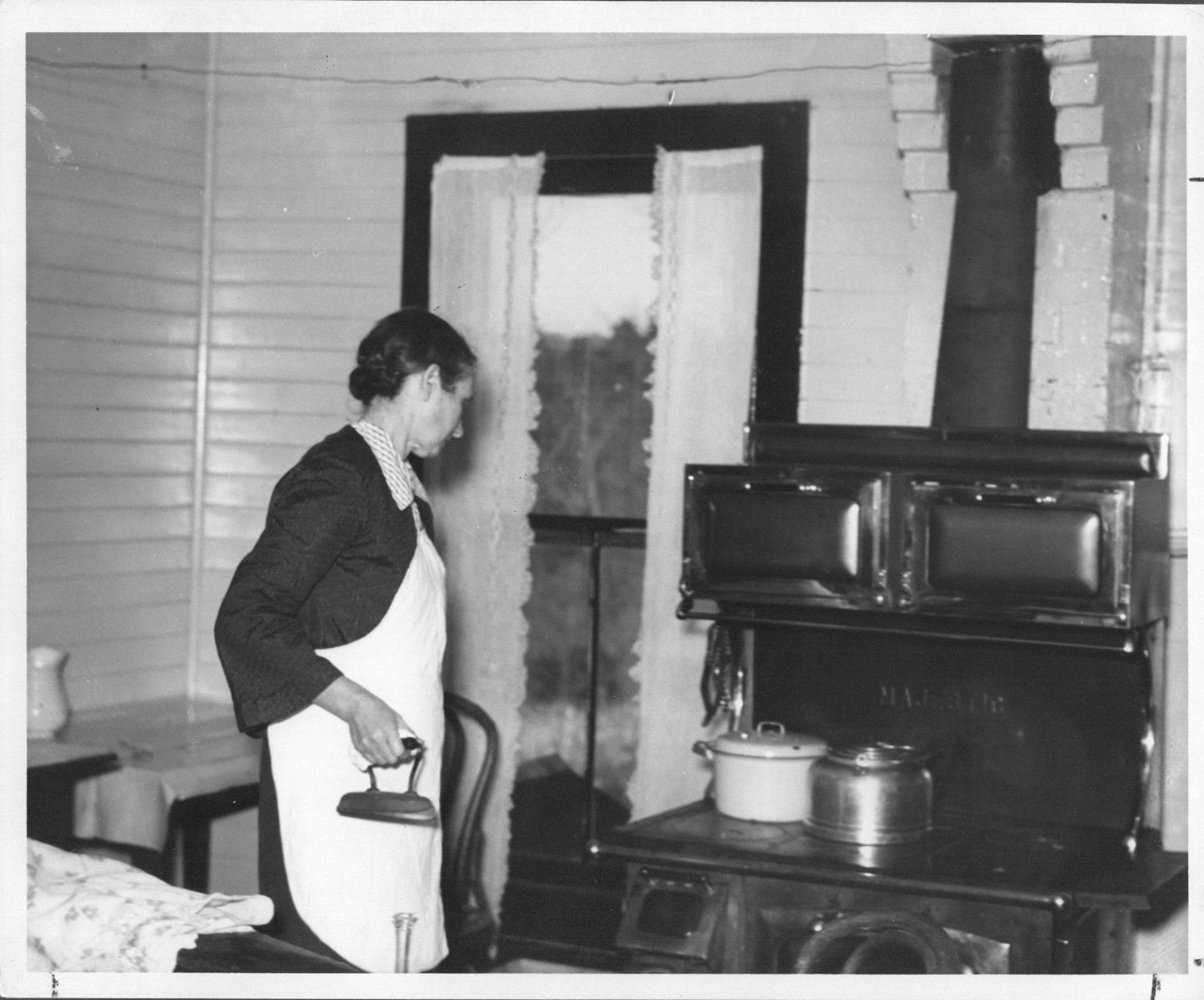 warming iron on stove
