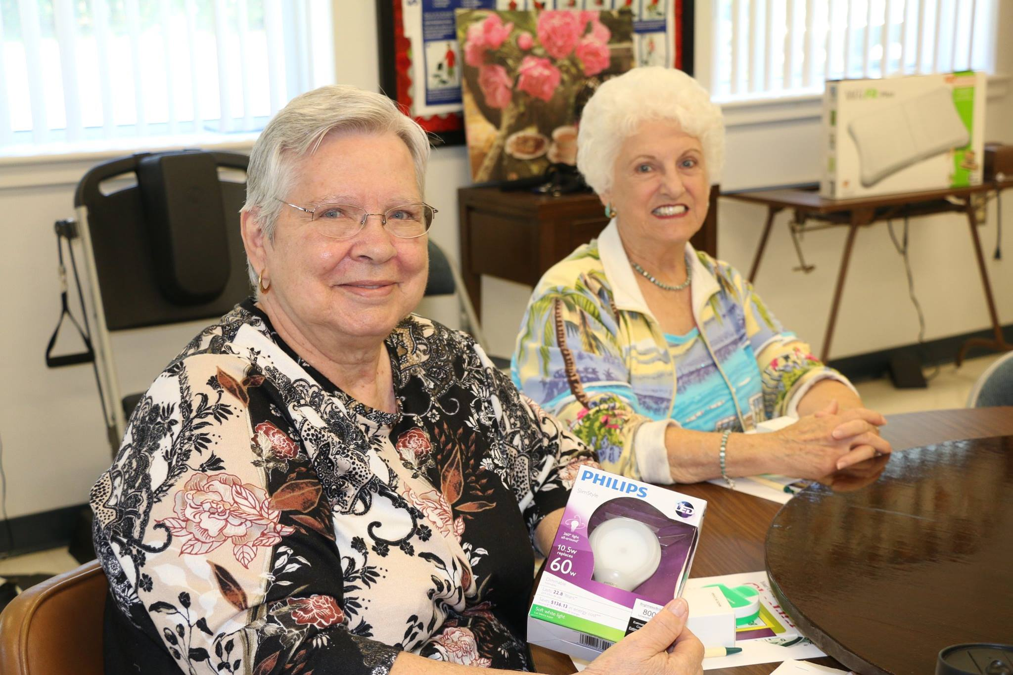 ladies sitting with lightbulbs senior center