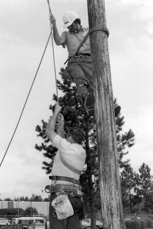 climbing up a pole Larry Gilmore